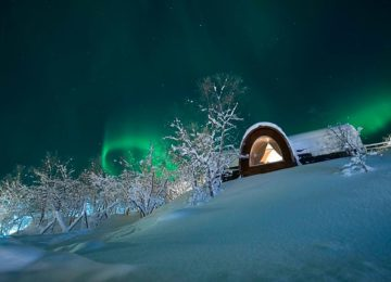 Spend a night in a cosy Gamme Cabin and you might catch a glimpse of the Northern Lights during winter. Photo © Snowhotel Kirkenes